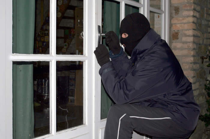 Burglar breaking into your home